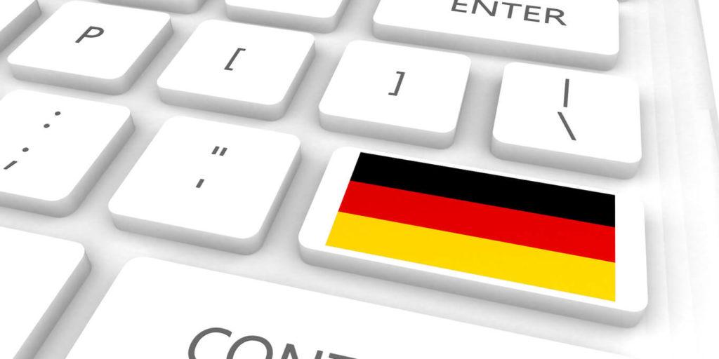 Blockchain studieren - Tastatur Deutschland Fahne