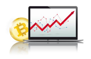 Bitcoin Goldmünze mit Bildschirm und Chart